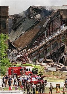 the Pentagon building burst into flames and a portion of the five-sided structure collapsed after the west wall of the building was hit by the hijacked American Airlines Flight 77 at 9:40 a.m