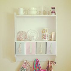 New kitchen shelves...painted, hung and covered in vintage pinnies and pretty tea & hot chocolate crockery