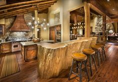 rustic-cabin-kitchen-design-with-log-wood-bar-table-and-unique-chandelier-on-vaulted-ceiling-over-marble-countertop-kitchen-island-also-natural-stone- ...