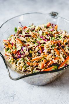 Slaw with Ginger Peanut Dressing An image of a healthy, crunchy Asian slaw with a Ginger Peanut Dressing in a glass bowl.An image of a healthy, crunchy Asian slaw with a Ginger Peanut Dressing in a glass bowl. Vegan Coleslaw, Coleslaw Mix, Healthy Coleslaw Dressing, Soup And Salad, Pasta Salad, Peanut Dressing, Cooking Recipes, Healthy Recipes, Summer Salads