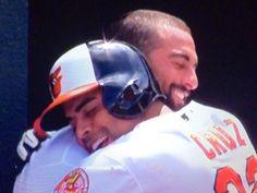 Nick Markakis gets a hug from Nelson Cruz