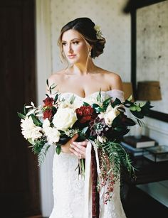 Wedding Dress: Mon Cherie - http://www.stylemepretty.com/portfolio/mon-cherie Floral Design: Virtu Floral and Event Design - http://www.stylemepretty.com/portfolio/virtu-floral Photography: A Thomas Photography - www.athomasphotography.com   Read More on SMP: http://www.stylemepretty.com/2016/12/21/red-greenery-rustic-wedding/