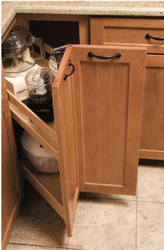 "A truly unique alternative to the lazy susan, the Corner Pantry is fabricated from solid maple and plywood construction. Heavy-duty, 125lb full extension drawer slides make it ideal for pots, pans, kitchen appliances or bulk storage. The corner pantry is designed for either a 33"" or 36"" corner cabinet and comes premounted with a plywood sled for easy installation. 33"" corner/10 1/8"" $305.72  36"" corner/14 1/2"" $292.06"