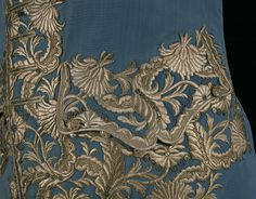Glistening silver embroidery decorates the pocket flap of this blue silk waistcoat dating from the 1740s.