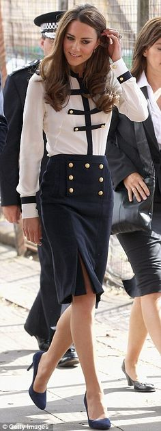 Kate wore a silk blouse and matching pencil skirt by Alexander McQueen designer Sarah Burton
