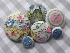 Embroidered buttons by Feeling Stitchy...hand stitched liberty print fabric.