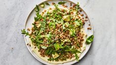 Big Green Lentil Salad: Cool yogurt, crunchy seeds, and avocado turn lentils into a lunch salad you'll actually be excited to eat. Serve it with warm pita for swiping up the garlicky yogurt. Green Lentil Salad, Yogurt, Lentil Salad Recipes, Dried Lentils, Vegetarian Cookbook, Vegetarian Recipes, Healthy Recipes, Avocado Recipes, Delicious Recipes