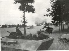 """Numbers of SdKfz 251/1 halftracks of the 5th SS Wiking Division in action August 15th 1944 in Poland. Note there is a single Panzerschreck mounted on the outside of the closest vehicle. They were derived from the American """"Bazooka"""" after the Germans encountered their use during D Day in Normandy."""