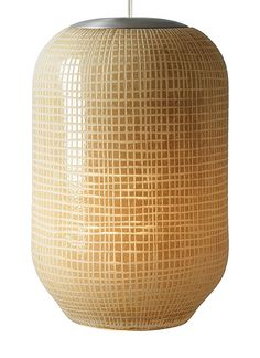 Mouth-blown glass is hand-etched in this modern twist on a traditional Japanese lantern.
