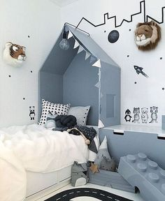 Love this room. Blue, tiger on the walls. Creative kids room.