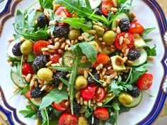 Olive, pine nut and and zucchini salad with cherry tomatoes and avocado