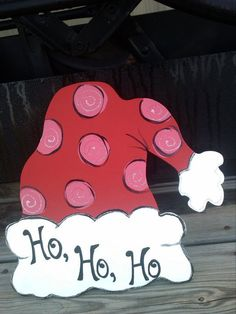 Whimsical Glittered Personalized Wooden Door Hanger Santa Hat. $20.00, via Etsy.