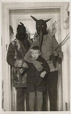 The masks in this old picture are somehow more unsettling than anything you could purchase at a horror shop today..