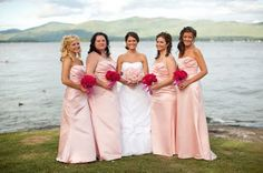 Pretty in pink.  The girls carried raspberry colored bouquets and the bride matched the girls' dresses by carrying a soft pink textured bouquet.  McKee wedding, Inn at Erlowest.  Photo by Gallery 9 North.