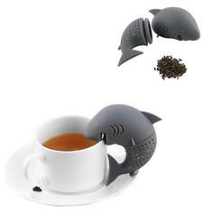 The limited edition Shark Tea Infuser sits with its jaws on your mug and brews your tea.