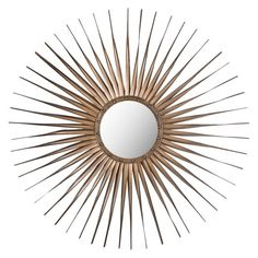 The sunburst Windsor Mirror, at just less than 34 inches wide, pairs an old, hand-crafted edge with contemporary styling. The round mirror frame, finished with nail head detail, proves a perfect foil to radiant gold-finished iron rays.