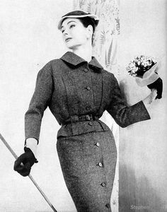 Anne Gunning wearing a suit by Dior, Vogue 1954