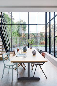Woonhuis - Vught www.burokoek.nl/ Baksteen - Stalen kozijn - Zwart kozijn - Beton vloer - Aanbouw- Vide - Gerecycled trap - Glas - Eiken hout - Eet tafel