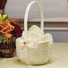 The French Lace Flower Girl Basket, shown in Ivory.
