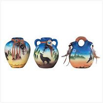 """Mini Southwest Vase Set. Each of these 4"""" ceramic vases is evocatively painted with the silhouette of a different desert creature standing in the mystical twilight. 3 1/2"""" x 4 1/2"""" high. Set of 3.                Item:  34235    Price: $17.95  My Price: $10.77  (40% Off)"""
