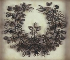 "This was the flowers that women made out of their hair ... sometimes made as mourning pieces as well as ""family trees"" of hair collected from family members.  From Rapunzel's Delight blog."
