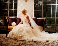 Elegant bridal portrait- Love the floral detail on the bottom of this dress!