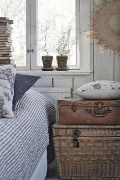 The use of classic ticking stripes, toile and floral fabrics is a look that can can cross over many decorating styles. French country, classic, coastal, and cottage. Using the lovely wicker trunk and vintage leather case gives a lovely homely feel. Vibeke Design, Wicker Trunk, Wicker Baskets, Vintage Farmhouse, Country Farmhouse, Swedish Farmhouse, Coastal Country, Swedish Cottage, My New Room