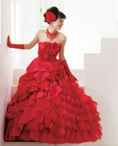 Alternative wedding dresses. Getting married in red is a bold but beautiful move. Look at some of the most beautiful red gowns, and read about Lucy who got married in red.