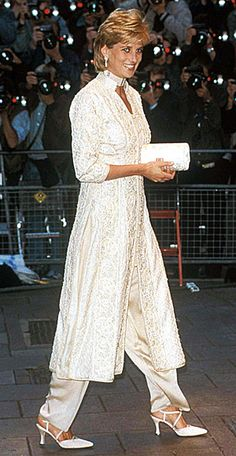 1996 She wore an ivory pearl-studded shalwar kameez to a cancer fundraiser in London. The pantsuit, which was a gift from friend Jemima Khan, inspired her to commission similar Pakistani-inspired outfits from Catherine Walker.