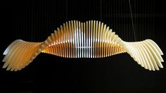 Creation Cinema, Undulating Bird-Like Kinetic Sculpture Displays Images As It Moves