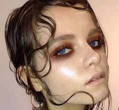wet pieces of hair places in curls on the face! Dewey makeup