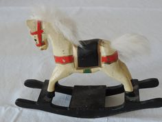 very old rocking horse for the little boy in you dollhouse