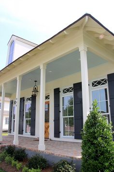 Haint Blue porch ceiling, French Quarter Green shutters, antique brick in a herringbone pattern, and Bevolo gas lantern House Paint Exterior, Exterior Paint Colors, Exterior House Colors, Haint Blue Porch Ceiling, Green Shutters, Colored Ceiling, Ceiling Color, Ceiling Design, Blue Ceilings