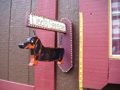 personalized hanging dachshund wiener dog sign by LazyHoundWorkshop on Etsy https://www.etsy.com/listing/115453102/personalized-hanging-dachshund-wiener