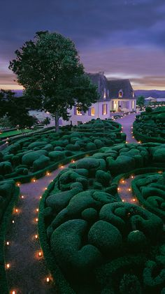 Candlelit gardens at Château de Marqueyssac in Perigord, France • photo: Marqueyssac