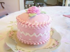 Sweet Pink Cake PIN CUSHION....Rick Rack Rose on Top... (found here -> http://www.etsy.com/listing/43645972/sweet-pink-cake-pin-cushionrick-rack)