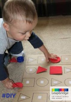 "Want to teach your child shapes? Why not make it fun with this ""do it yourself"" game? All you need is cardboard, chart paper and some double sided tape."