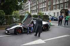 A valet assists the owner as he exits his Kuwaiti-registered Lamborghini Aventador Oakley Design AlRashed Carbon Edition on July 2015 in London, England. London has become known in recent. Get premium, high resolution news photos at Getty Images Customize My Car, Miniature Cars, London Property, Car Museum, Lamborghini Aventador, Antique Cars, Racing, In This Moment, Vehicles