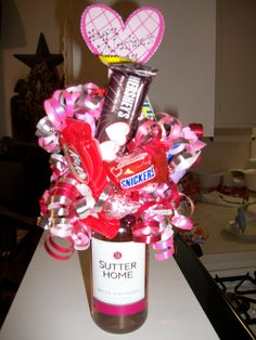 An adult version of a candy bouquet.  Instead of a can of soda/pop, used a single serving bottle of wine, topped with a pool noddle and hot glued candy and ribbon to the noddle. When ready to drink, just remove the candy/ribbon top, slides right off.