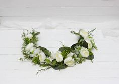 Flower crown is decorated with fabric flowers ,artificial greenery and preserved greenery. Details ------------------------------------------------------------------------ Flower crown created without use of glue -------------------------------------------------------------------------