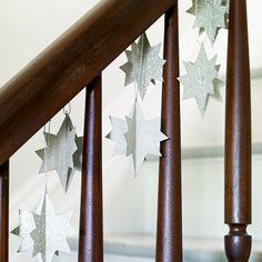 Create your own Milky Way up the stairs by hanging clusters of glittery stars from the railing. - FamilyCircle.com