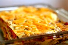 Tex-Mex lasagna, also known as Mexican casserole or Mexican lasagna recipe.  Layered casserole with corn tortillas, ground beef, chile, beans, salsa, and cheese.