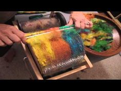 ▶ How to make puni rolags on a drum carder with Soffsilk silk waste - YouTube