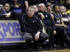 West Virginia Coach Bob Huggins, left, watches from the bench along with assistant coach Billy Hahn and guard Gary Browne, right, in the closing minutes of the team's 79-52 loss at Purdue on Saturday.