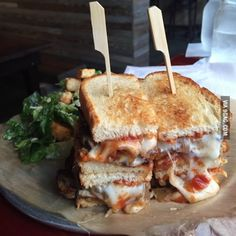 Meatloaf sandwich on sourdough with caramelized onions, swiss cheese and a spicy ketchup glaze.