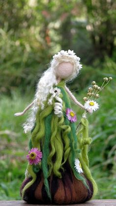 Needle felted spring doll. Created from different kinds of fibers, brown/green dress, decorated with dry flowers. Beautiful mohair hair. OOAK This needle felted standing fairy is about 9 tall She is full of love, happiness and silence, bringing a nature to her new house. She can make someone happy as a present, be a nice home decoration or a part of your nature table. Thank you for visiting my shop!! Please see my shop policies for more information…