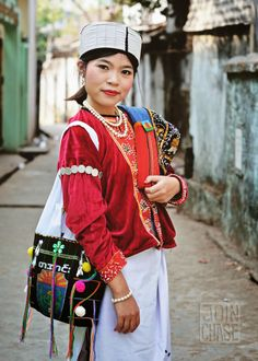 Traditional Palaung clothing is bright and layered. A member of the group poses for a shot. Yangon, Myanmar. Shot by Greenheart Travel Correspondent Chase