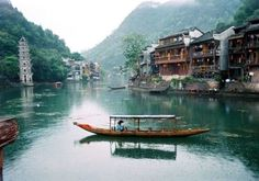 Fenghuang City is renowned for its splendid Miao culture, especially the Miao-style stilted houses. Photo Ctedit