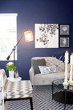 Living room with navy blue wall and gray sofa.     By Cole Barnett Interiors    ColeBarnettInteriors Boards - Zillow Digs