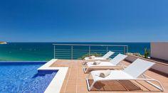 Vila Mar a Vista is a beautiful villa for rent in Budens, Portugal. View info, photos, rates here. Algarve, Infinity Pool, Fine Sand, Natural Curiosities, Beautiful Villas, European Destination, Beautiful Landscapes, Sun Lounger, Beach House